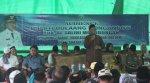 Bupati Hi Salihi Mokodongan menyampaikan sambutan pemerintah pada agenda kunjungan safari ramadhan di desa siniyung kecamatan dumoga pada hari jumat 19 juli 2013